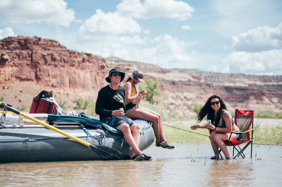 People sitting on a raft.